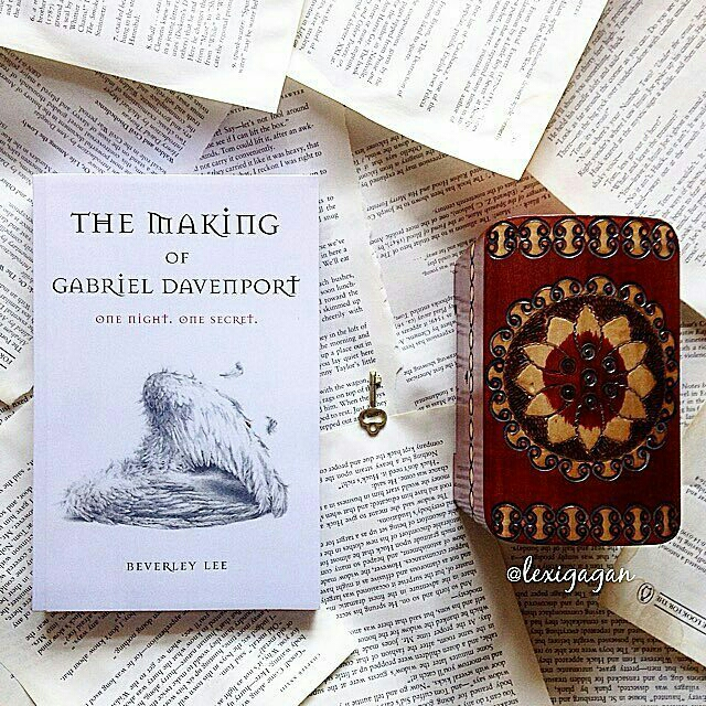 Bookstagram photo of book with key and small box